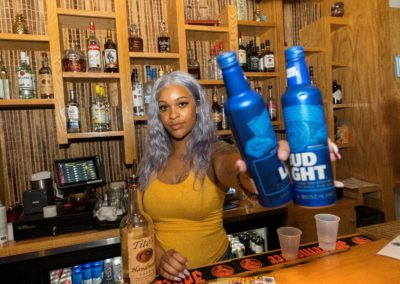 Coconutz Bartender holding Bud Light